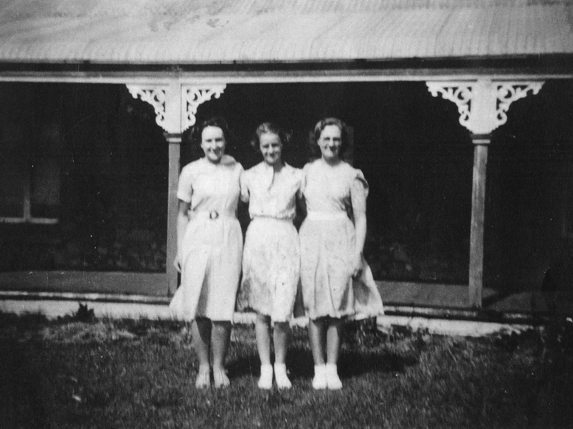 Three young ladies (Meg, centre, with Daphne and Iris) posing outside the Rectory in a photo they called 'Three Flowers', 1935