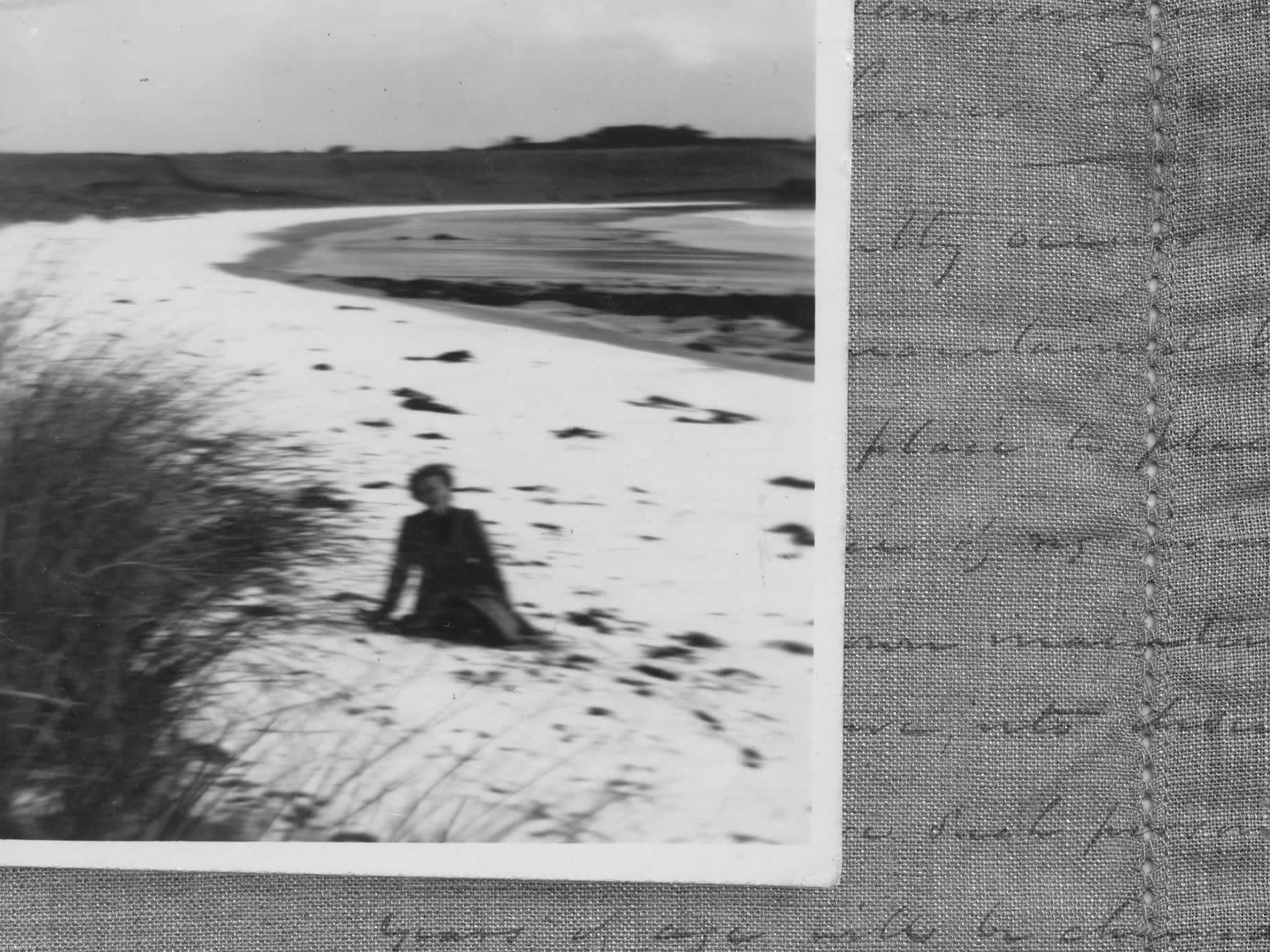 A rare picture of snow on Godfreys Beach, with Meg pictured in foreground, 1943