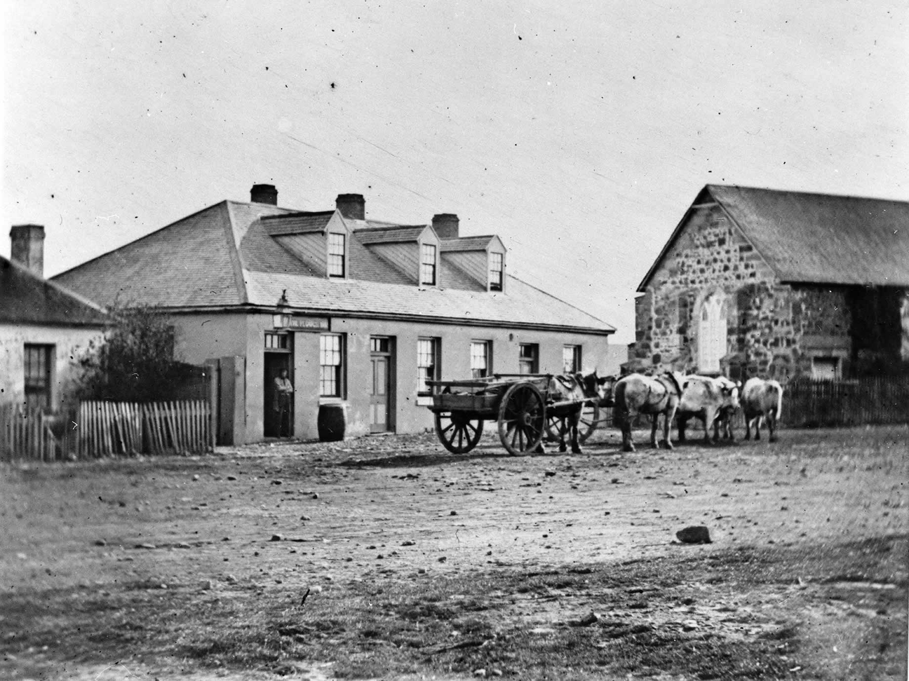 Horse and cart waiting outside the Plough Inn, 1870